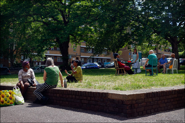 Residents on grass area outside Pitman House
